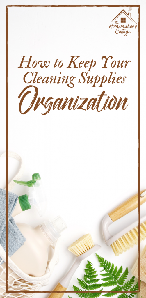 Cleaning supplies flat laid out on a white surface with copy space.